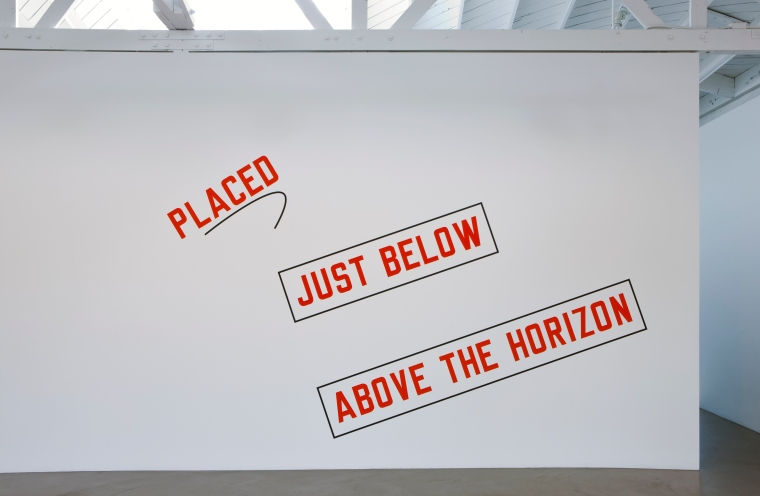 "Lawrence Weiner's painting, ""Placed Just Below Above the Horizon"""
